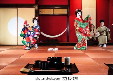 JAN 23, 2014 : Sakata, Yamagata, Japan : Japanese Maiko, Geisha in red costume, traditional entertainer sit in Tatami floor room, rich culture of Japan.