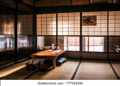 JAN 24, 2014 Fukushima, Japan : Japanese style room with Tatami and paper door, wooden table with low key light, warm atmosphere