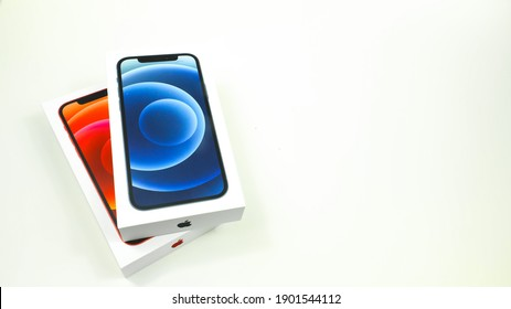 Jan 24th 2021. York, P.A. Illustrative editorial image of apple iPhone 12 boxes in blue and red, the latest from apple iPhone.