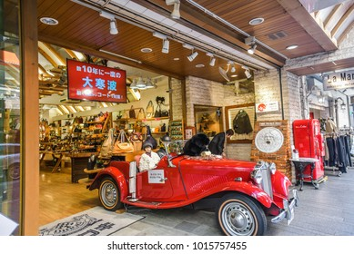 Jan 27,2017 : Japan - Shoes shop on  Motomachi shopping street displays red vintage car in front of the shop.