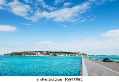 JAN 28, 2013 Naha, Okinawa, JAPAN : Kouri bridge cross over beautiful turqouise blue sea to Kouri island, Naha, Okinawa, Japan