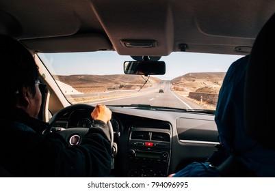 JAN 3, 2018 Uchisar, Nevsehir, Turkey : Driving car on the empty desert road, travel road trip background