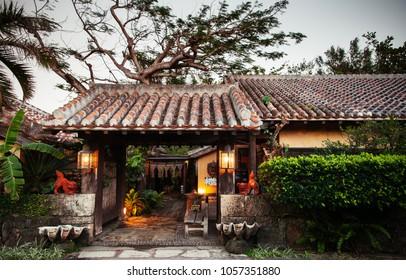 JAN 30, 2013 Okinawa, Japan : Japanese Okinawa style house with tiles roof in garden, vintage Japanese Okinawan architecture