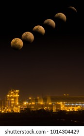 Jan 31,2018 : Lunar eclipse time-lapse with night light view of a cogeneration power plant, Ayutthaya province, Thailand
