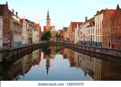 Jan van Eyckplein, old town of Bruges in Belgium at sunset time (Jan van Eyckplein, Bruges, Belgium)