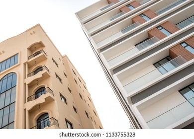 JANABIYA, BAHRAIN - 18 MARCH, 2017: Newly constructed apartment blocks tower over a residential area in Bahrain.