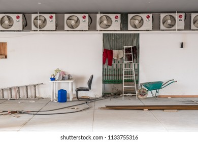 JANABIYA, BAHRAIN - 18 MARCH, 2018: Construction worker equipment and clothing occupies the parking lot under an incomplete apartment building.
