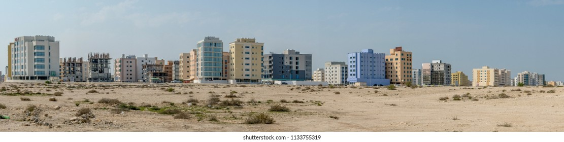 JANABIYA, BAHRAIN - 3 MARCH, 2017: A panoramic view of the upcoming Janabiya area of Bahrain showing apartment blocks, some under construction, and the desert.