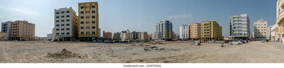 JANABIYA, BAHRAIN - 3 MARCH, 2017: A panoramic view of the upcoming Janabiya area of Bahrain showing apartment blocks and the desert.
