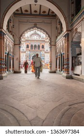 Janakpur, Nepal - March 31, 2019: People walking under the beautiful arch of the Ram Janki temple. The temple is beliwved to be the place where Hindu Lord Rama married Sita.