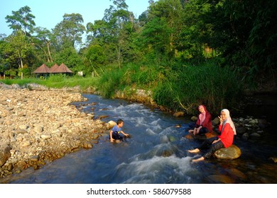 Janda Baik , Malaysia - August 30  , 2015: Siblings  having fun in river on sunny outdoors.