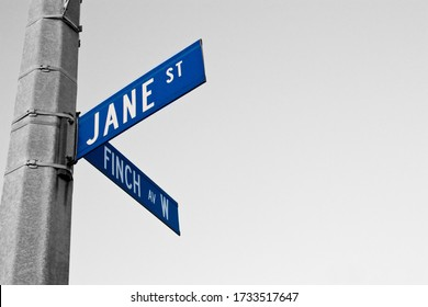 Jane Street and Finch Avenue W street sign at the corner of the intersection.
