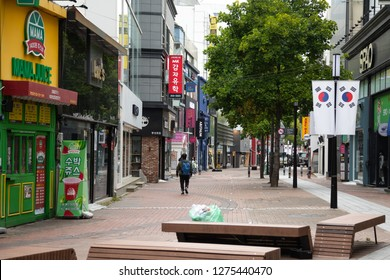 Janggwan-Dong, Daegu, South Korea - October 9 2018: View up an empty shopping district and commercial street in downtown Daegu