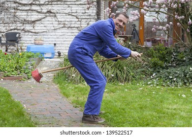 janitor having fun and riding a broom during break at work