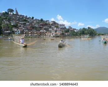 Janitzio, Michoacan /Mexico - June 18, 2017: Fishermen in small boats on Lake Pátzcuaro in the state of Michoacán, Mexico.