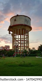 Jankipuram Lko UP India, 28 July 2019, A glorious Sunset scene of a overhead water tank or water tower located in a park behind Icon hospital