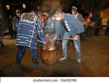 January 01, 2017 Zojoji Temple, Tokyo,Japan. 'Mochitsuki' (pounding mochi), Japanese traditional practice to commemorate the New Year. Glutinous rice flour pounded a large mortar with a wooden mallet