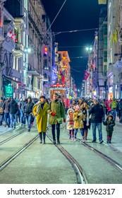 January 04, 2019: Nostalgic Red Tram in Taksim Istiklal Street at evening. Taksim Istiklal Street is a popular destination in Istanbul. Beyoglu, Taksim, Istanbul. Turkey.