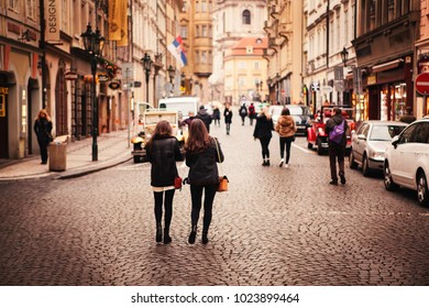 january 10, 2018 in czech prague. tourist and young people are wandering in praha street for sightseeing. intended add noise like film image.