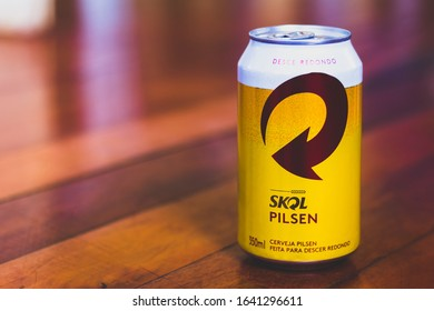 January 10, 2020, Brazil. Skol Pilsen beer can on wooden background. Drink is a beer brand owned by the Danish company Carlsberg.