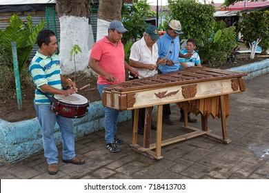 January 11, 2015 Flores, Guatemala: men playing marimba music on the street of the popular tourist destination island