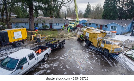 January 11, 2017. Eugene, Oregon, USA. Elevated perspective of arborist and tree service cleaning up during the removal of damaged trees after an ice storm.