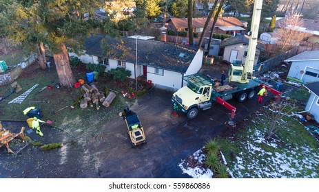 January 11, 2017. Eugene, Oregon, USA. Elevated perspective of a tree service work site and workers remove and cleanup trees damaged in an ice storm.