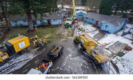 January 11, 2017. Eugene, Oregon, USA. Aerial perspective of a worksite and tree service crew removing damaged trees after an ice storm showing entire worksite.