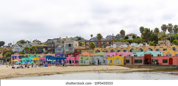 January 14, 2017 - Capitola, California: Beachgoers enjoy a sunny, cool day on the beach of Capitola know for their colorful bungalows.