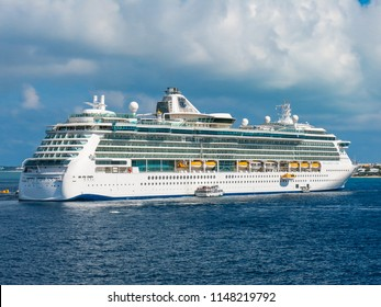January 14th, 2015. Grand Cayman, Cayman Islands. Royal Caribbean's Brilliance of the Seas docked moored with tenders taking passengers to shore.
