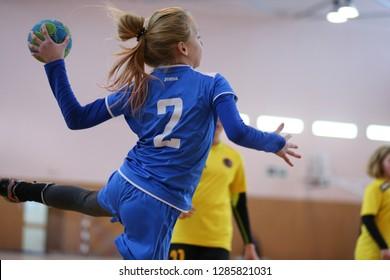 JANUARY 15, 2019 - KHARKIV, UKRAINE: All-Ukrainian Kids Handball Tournament. Young girls playing indoor handball. Sports and physical activity. Training and sports for children.