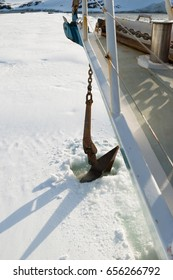 January 15th 2014: Sailing boat stuck in ice sheet in Antarctica dropping anchor