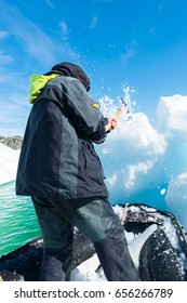 January 15th 2014:: Skipper collecting ice from iceberg to get fresh water on expedition in Antarctica