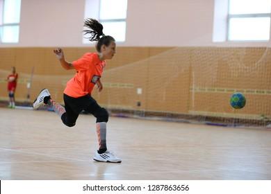 JANUARY 16, 2019 - KHARKIV, UKRAINE: All-Ukrainian Kids Handball Tournament. Young girls playing indoor handball. Sports and physical activity. Training and sports for children.