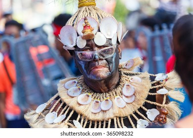January 17th 2016. Kalibo, Philippines. Festival Ati-Atihan. Unidentified people on parade in carnival costumes. Documentary Editorial Image.