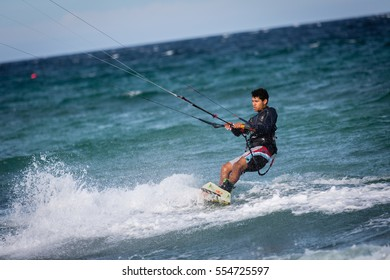 """January 18, 2015.  """"Lord of the Wind Baja"""", Los Barriles, Mexico.  A kiteboarder pushing water during a kiteboarding competition on the Sea of Cortez."""