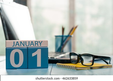 January 1st. Day 1 of month, calendar on teacher workplace background. Winter time. Empty space for text