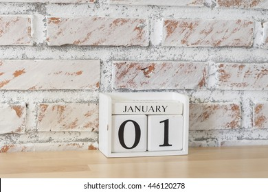 January 1st. Image of may 1 wooden color calendar on white brick wall background.   empty space for text. Happy new years.