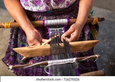 January 20, 2015 San Pedro la Laguna, Guatemala: hand of a Mayan woman making a traditional belt
