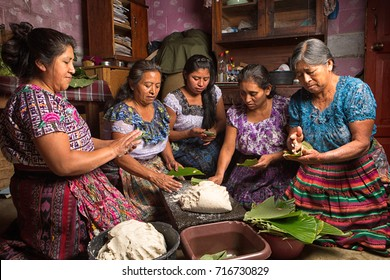 January 20, 2015 San Pedro la Laguna, Guatemala: tzutujil mayan women preparing traditional food together