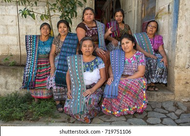 January 20, 2015 San Pedro la Laguna, Guatemala: illustrative editorial featuring a group of Mayan Tzutujil women in traditional clothing sitting in the front of a house