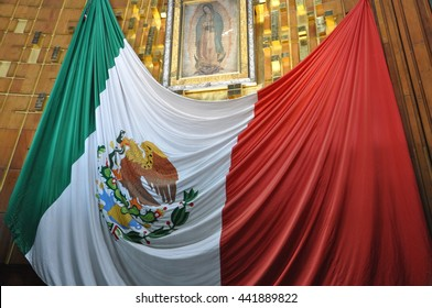 January 2016 - Basilica of Our Lady of Guadalupe, Mexico City: The Mexican Flag hanging underneath the shrine to Guadalupe inside the basilica.