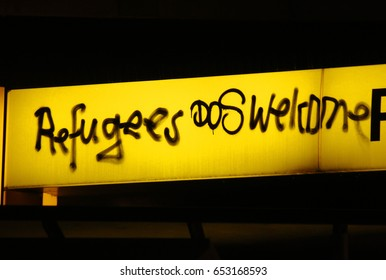 """JANUARY 2017 - BERLIN: a graffity with the political slogan """"Refugees Welcome"""", Berlin."""