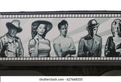 JANUARY 2017 - MALLORCA: John Wayne, Sophia Loren, Marlon Brando, Humphrey Bogart, Marilyn Monroe on a billboard in El Erenal, Mallorca.