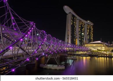 January 2017: Night time cityscape of Singapore - Marina Bay Sands with Helix Bridge