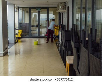 January 2017, Yangon Myanmar - An unidentified female worker/cleaner/janitor seen cleaning the floor at a hotel lobby in Yangon City