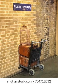 JANUARY 2018 - LONDON, UNITED KINGDOM: Platform 9 and 3/4 at Kings Cross Station, London. A trolly stuck in the wall where fans can pose for photos.