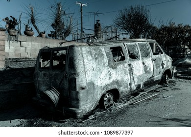 JANUARY 2018, VENTURA CALIFORNIA - Destroyed van and home from 2018 Thomas Fire off Foothill Road in the Via Arroyo and Via Pasito neighborhood, the largest fire in California history