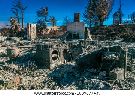 JANUARY 2018, VENTURA CALIFORNIA - Destroyed home and washer/drier from 2018 Thomas Fire off Foothill Road in the Via Arroyo and Via Pasito neighborhood, the largest fire in California history