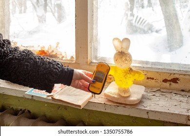 January 2019, Pripyat, Chernobyl, Ukraine. The thrown and destroyed kindergarten  in Pripyat. The instrument for measuring the level of radiation shows radiation above the norm